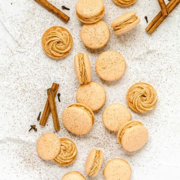 pumpkin spice macarons on table