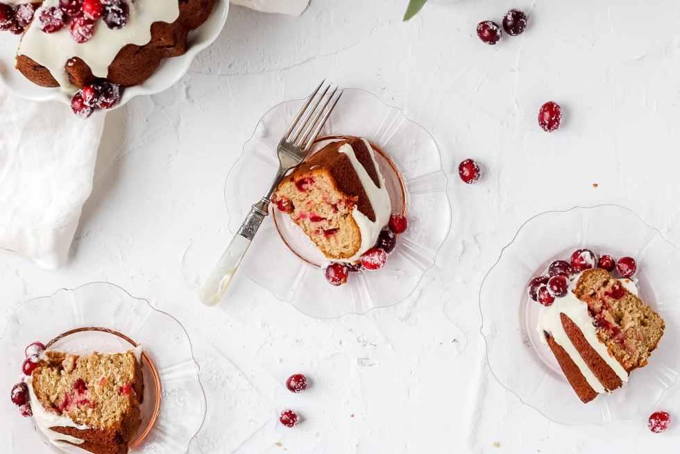 3 slices of cranberry bundt cake on depression glass plates