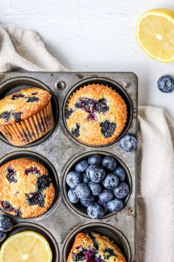 brown butter lemon blueberry muffins in muffin tin