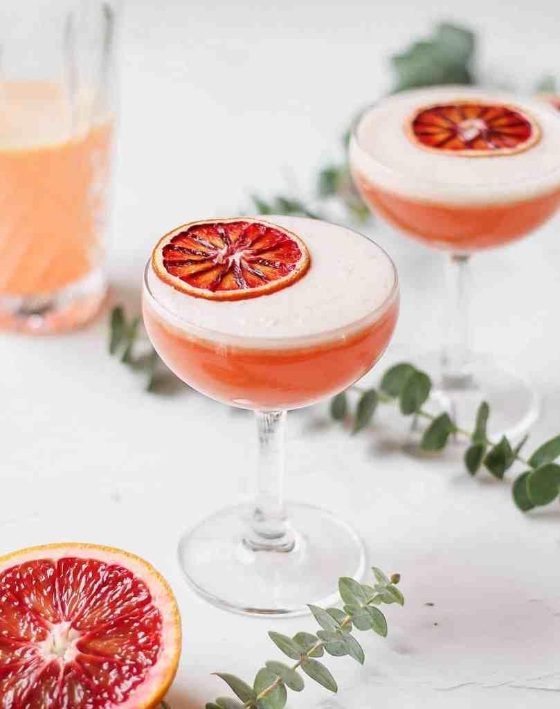 blood orange vodka sour with dehydrated orange slice