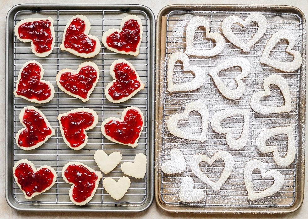 heart shaped linzer cookies filled with raspberry jam before assembly