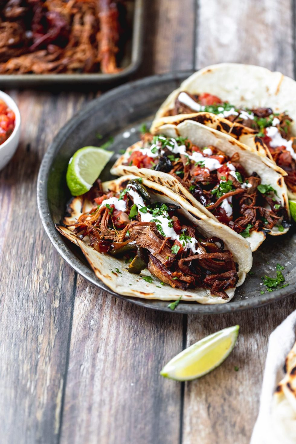 beef tacos with salsa and sour cream on top