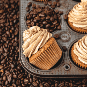espresso cupcakes on a bed of coffee beans