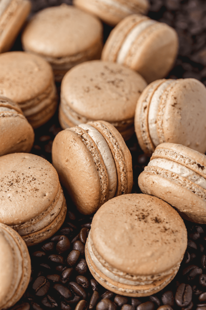espresso macarons on bed of coffee beans