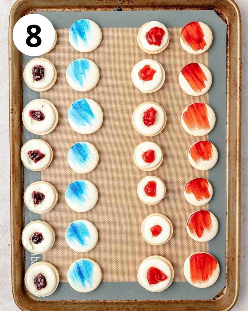 red white and blue painted macarons with cream cheese and berry filling
