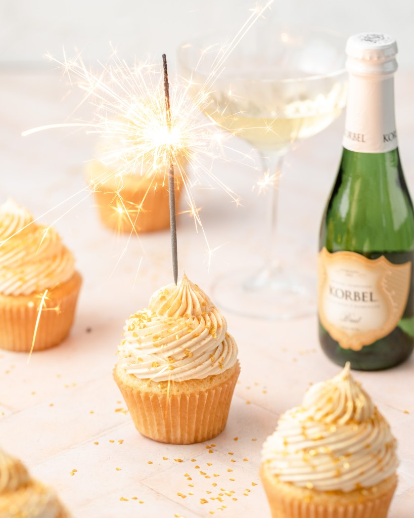champagne cupcakes with sparkler on top