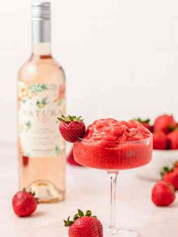 strawberry frosé with bottle of rosé in the back