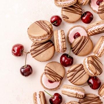 chocolate cherry macarons with fresh cherries