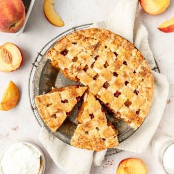 brown butter bourbon peach pie cut into slices