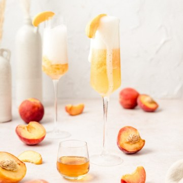 peach Bellini's with sliced peaches on top