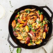 roasted chicken with peaches topped with herbs