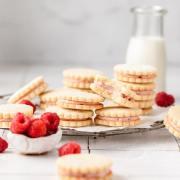 lemon raspberry sandwich cookies with fresh raspberries
