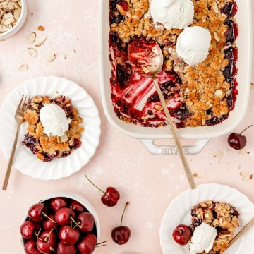 fresh cherry almond crisp with vanilla ice cream and scoop missing for featured