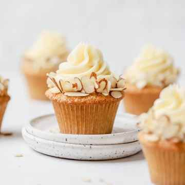 close up shot of almond cupcakes with swiss meringue buttercream