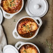 close up shot of french onion soup in small ramekins