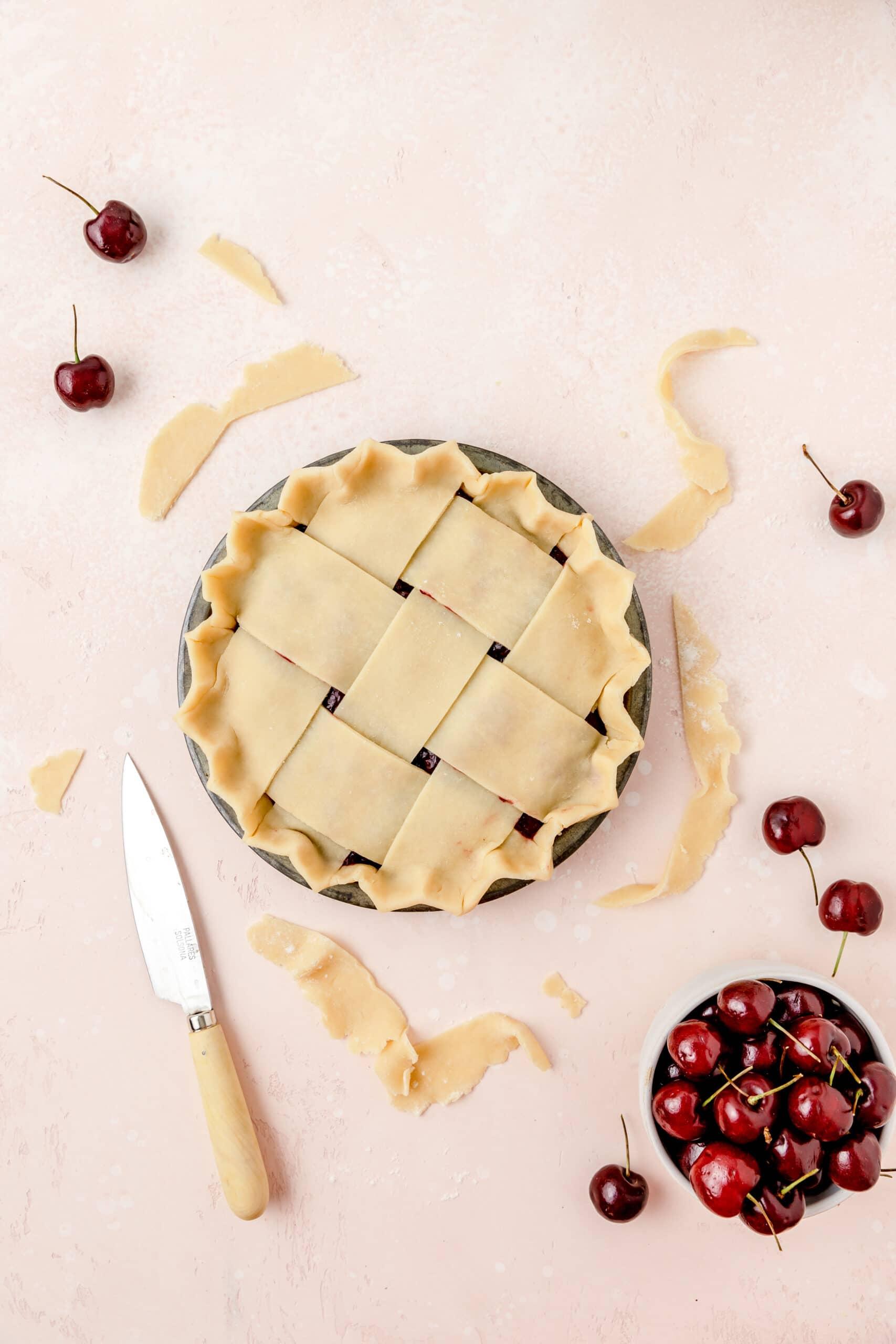 cherry pie with lattice homemade pie crust before baking