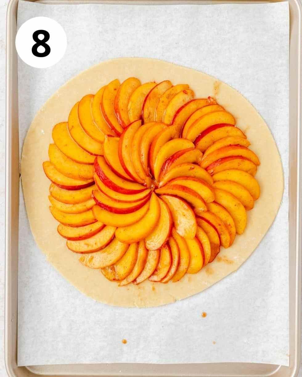 spiced peaches arranged on pie dough