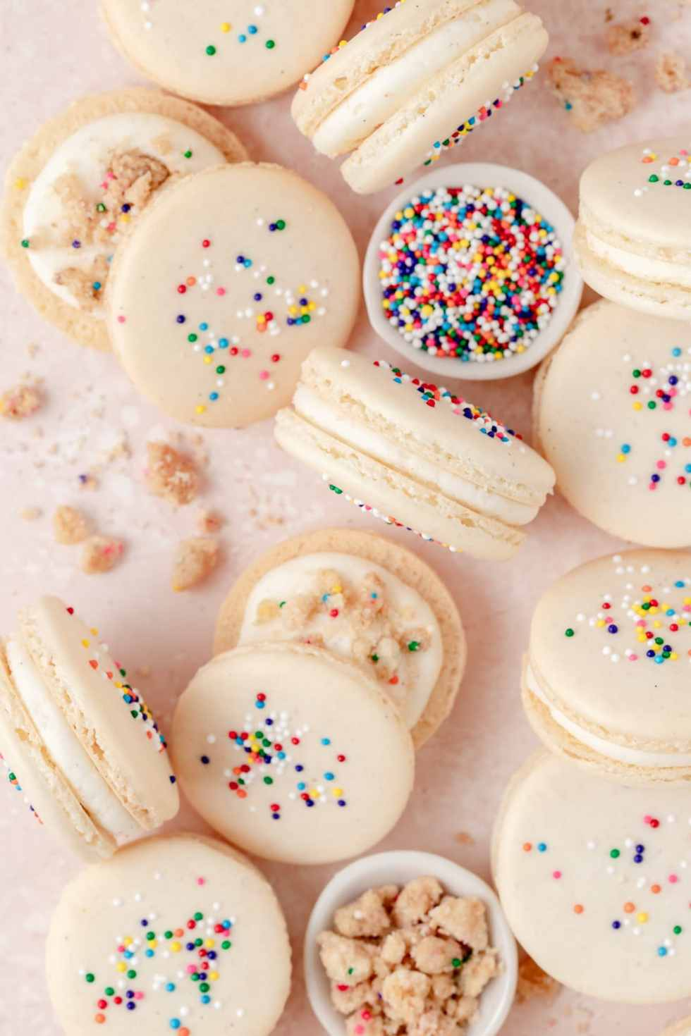 birthday cake macarons with cake crumbs and vanilla frosting