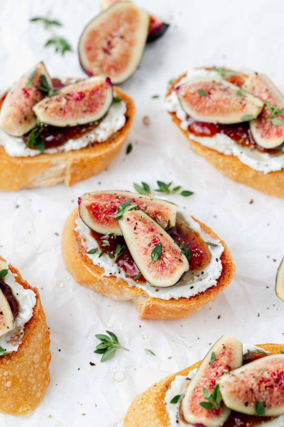 fig and goat cheese crostini with fresh thyme on top