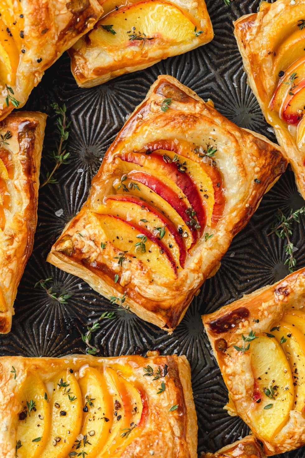 peach thyme tarts with gruyere and puff pastry