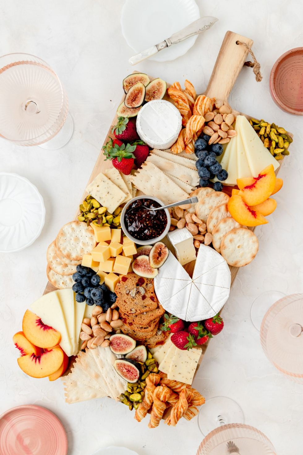 summer cheeseboard with rose wine and small plates