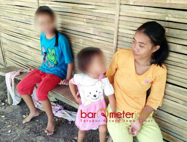 KORBAN OPINI DEBAT: Melinda Yesa Maharani bercanda bersama ibu dan kakaknya. Disebut Puti alami gizi buruk, nyatanya sehat-sehat saja. | Foto: Barometerjatim.com/ROY HASIBUAN