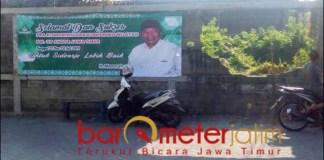 TES OMBAK PILBUP: Spanduk bergambar Haji Masnuh beri ucapan selamat pra dan Konferwil Ansor Jatim. | Foto: Barometerjatim.com/ROY HS