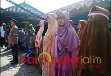 HUT RI: Peserta upacara HUT ke-74 RI di Desa Tenggulung, Solokuro. | Foto: Barometerjatim.com/HAMIM ANWAR