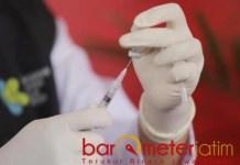 IKHTIAR: Vaksinasi, ikhtiar yang disepakati ahli dan pemerintah sebagai ulil amri. | Foto: Barometerjatim.com/ROY HS