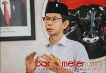 JAGA PROKES: Adi Sutarwijono, rayakan lebaran dengan tetap disiplin pada protokol kesehatan. | Foto: Barometerjatim.com/IST