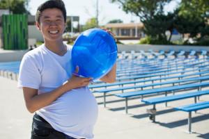 Ken Sakata ('18) humorously shows off his balloon before releasing it.
