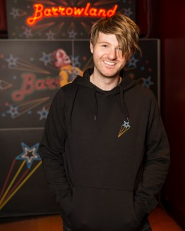Man wearing Black Barrowland sign hooded top
