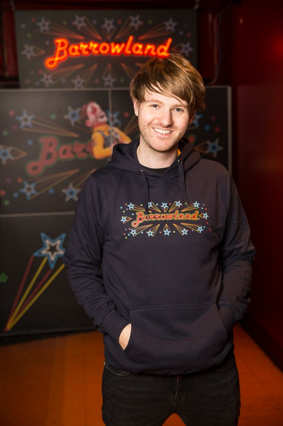 Man wearing Navy Barrowland sign hooded top
