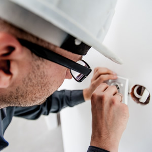 An engineer wiring up a socket