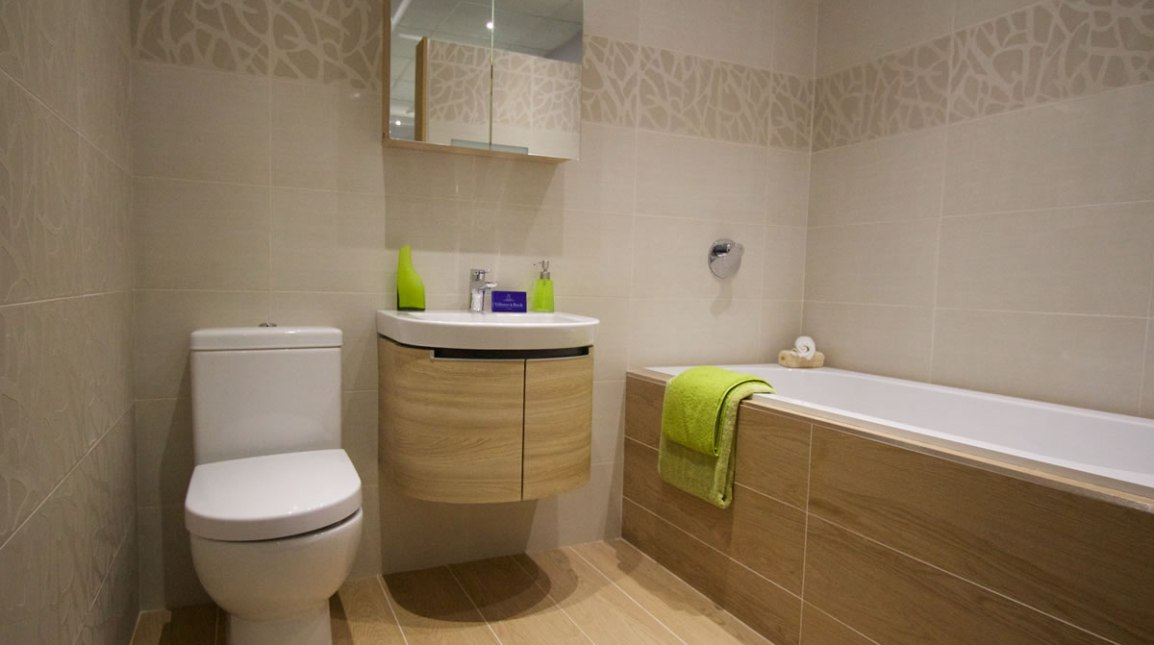 Bathroom with sink toilet and shower on the same wall