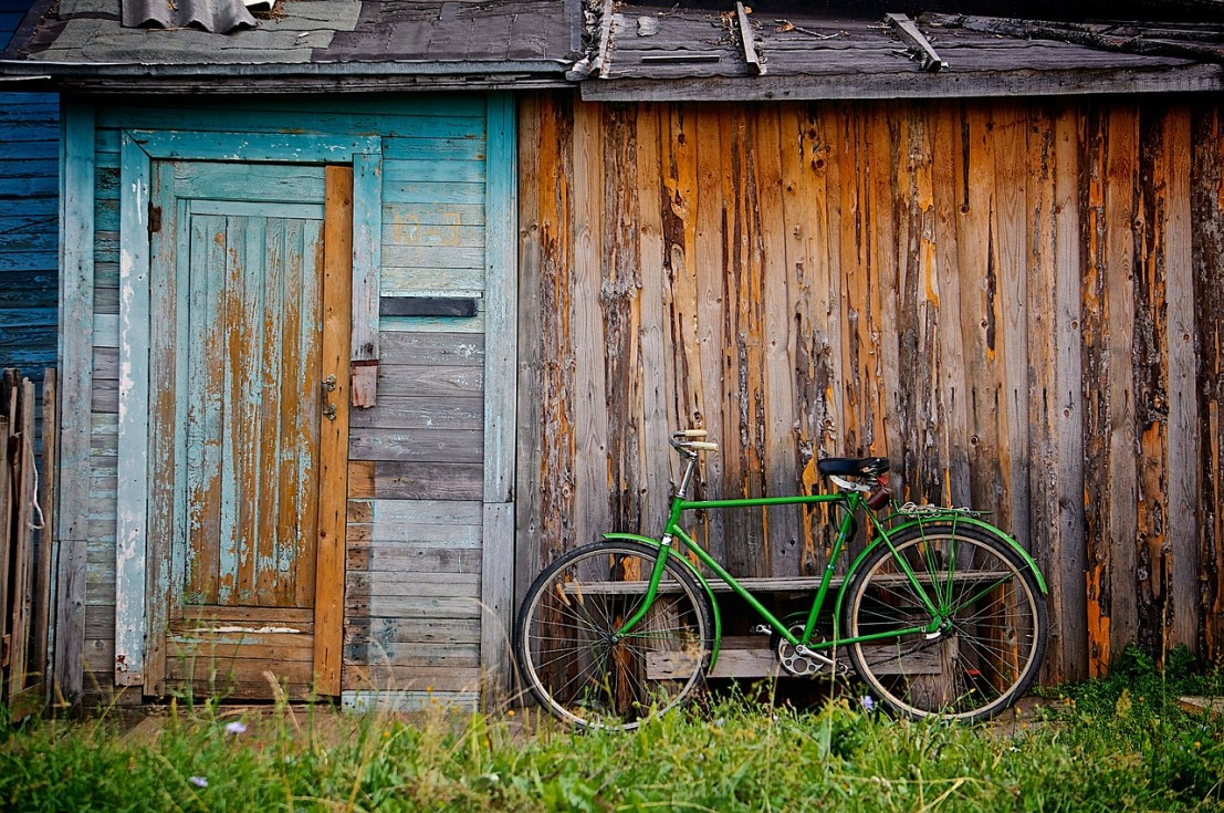a wooden house and a bicycle