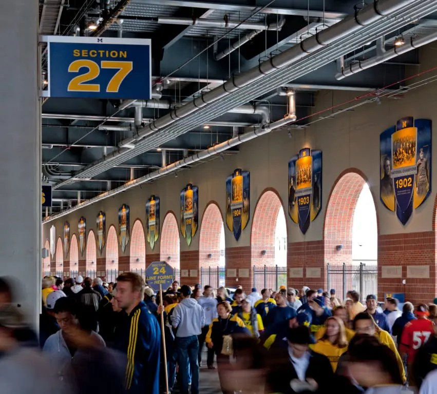 Michigan football fans entering section 27 from interior concourse