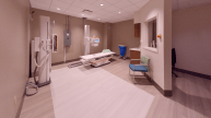 Room with x-ray machine and medical equipment