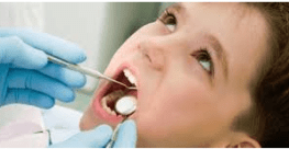 boy doing dental care in clinic