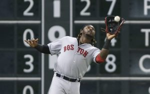 Jul 21, 2015; Houston, TX, USA; Boston Red Sox left fielder Hanley Ramirez (13) catches a fly ball during the fifth inning against the Houston Astros at Minute Maid Park. Mandatory Credit: Troy Taormina-USA TODAY Sports