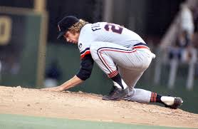 Fidrych manicuring the mound before an inning of work.