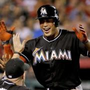 Giancarlo Stanton celebrating. CHRIS CARLSON/AP