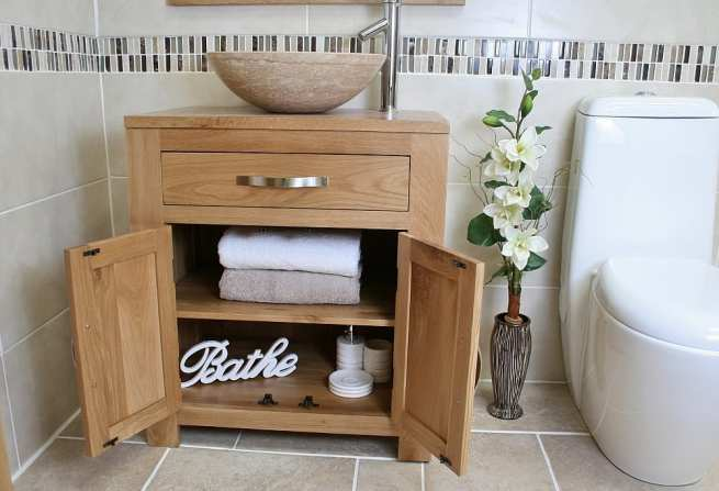 Front View of Travertine Basin on Single Oak Top Vanity Unit Showing Storage