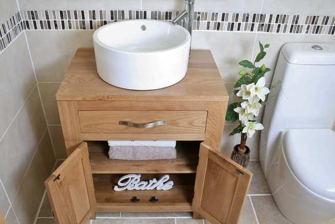 Above Close View of Round White Ceramic Basin on Oak Vanity Unit with Open Doors