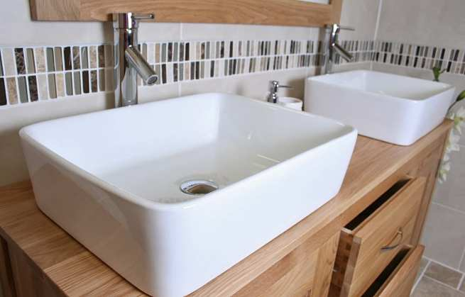 Side View of Two Rectangle Ceramic Basins on Oak Top Vanity Unit