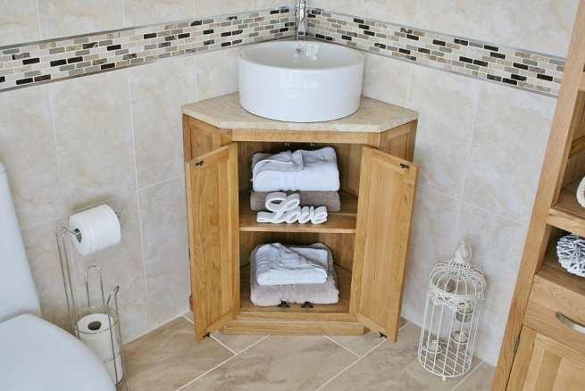 Corner Travertine Top Vanity Unit and Round Ceramic Basin Showing Open Cupboard