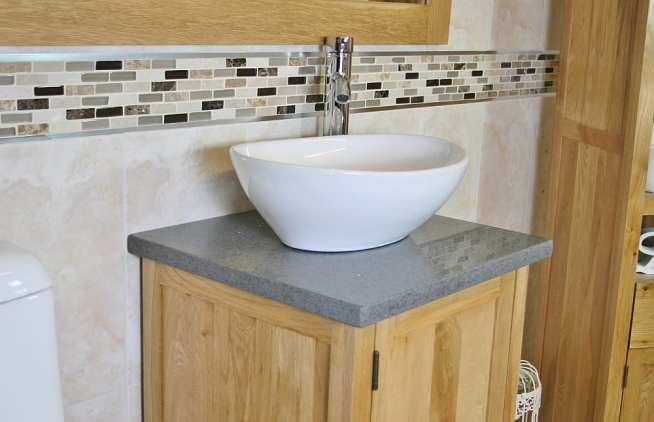 Close-up View of Oval White Ceramic Basin on Grey Quartz Topped Vanity
