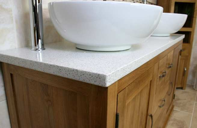 Close-up Side View of Round White Ceramic Basins on White Quartz Top Oak Bathroom Vanity