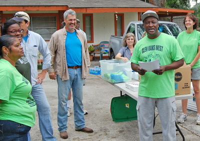 Rev. Donald Hunter, center, elicits smiles and laughter from members of Glen Oaks Neighborhood Association and The Chapel, including Rev. Kevin McKee, (L.) prior to a neighborhood clean-up project in August, 2014. photo by mark h hunter