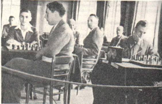 The 1938 British Championships at Brighton. L to R: Golombek; Frank Parr (tieless) ; C. H. O'D. Alexander; Sir George Thomas (partly hidden), Milner-Barry; E. G. Sergeant & A. Lenton.
